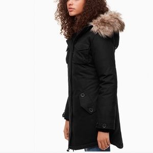 Black Community goose-down Parka. Sold at Aritzia.
